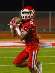 Carthage receiver Dee Bowens hauls in a pass in the Bulldogs' 55-37 win over Gilmer on Sept. 17, 2016 at Bulldog Stadium.
