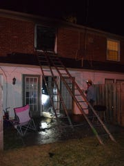 Firefighters extinguished a second-floor fire in a