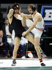 Wisconsin Badgers wrestler Eli Stickley, right, died at 21 last summer.
