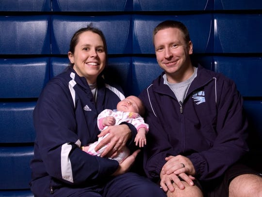 Hardin Valley Academy basketball coaches Jennifer and Keith Galloway with their 5-week old daughter, Sarah Kate pictured at HVA on Jan 13, 2010.