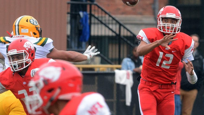 NFA quarterback Jayden Desilus passes the ball during the Wildcats' win over New London last season in Norwich.