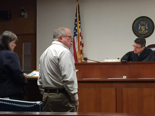 Lynn and Michael Higgins appear before District Judge Michael Hulewicz for their arraignment on animal cruelty charges Friday.