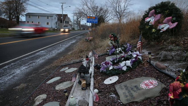 The roadside memorial for West Webster Firefighters Mike Chiapperini and Thomasz Kaczowka along Lake Road in Webster Wednesday, Dec. 20, 2017.  The pair were killed by a gunman who ambushed them when they responded to a fire five years ago on Christmas eve.