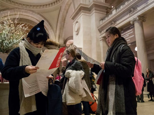 Visitors to the Metropolitan Museum of Art inspect