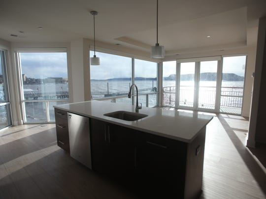 The interior of one of the unfurnished Harbor Square two-bedroom rental units. Large windows offer a view of the Hudson River, the Haverstraw ferry and a park.