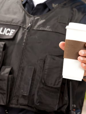 Police officer with coffee.