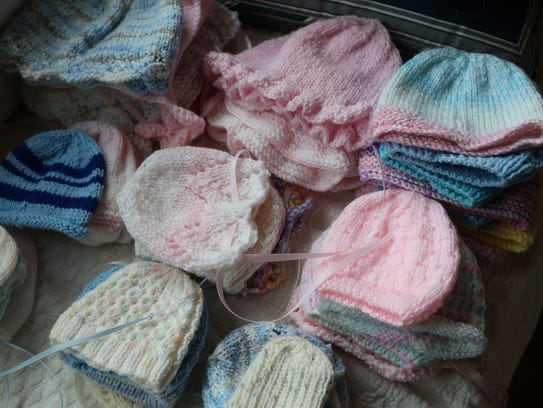 Handmade knit caps  are included with the burial gowns