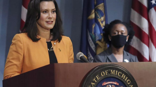 In this Aug. 19, 2020, photo provided by the Michigan Office of the Governor, Michigan Gov. Gretchen Whitmer addresses the state during a speech in Lansing. It is expected Whitmer will announce fitness centers, theaters, bowling alleys, ice rinks and related facilities can reopen after the Labor Day holiday.