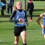 Olivia Theis helped Lansing Catholic finish fourth at the Division 3 state meet Saturday.