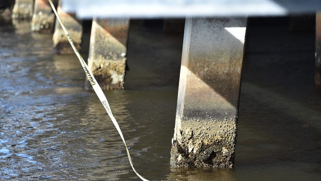 Barnacles and erosion are seen on the supports under the roadway of the bridge along Old Dixie Highway above Taylor Creek on Sunday, January 14, 2018, in Fort Pierce.