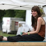 2012. Mara Pfeffer, a UD graduate, watches Imagine Dragons on The Backyard stage.