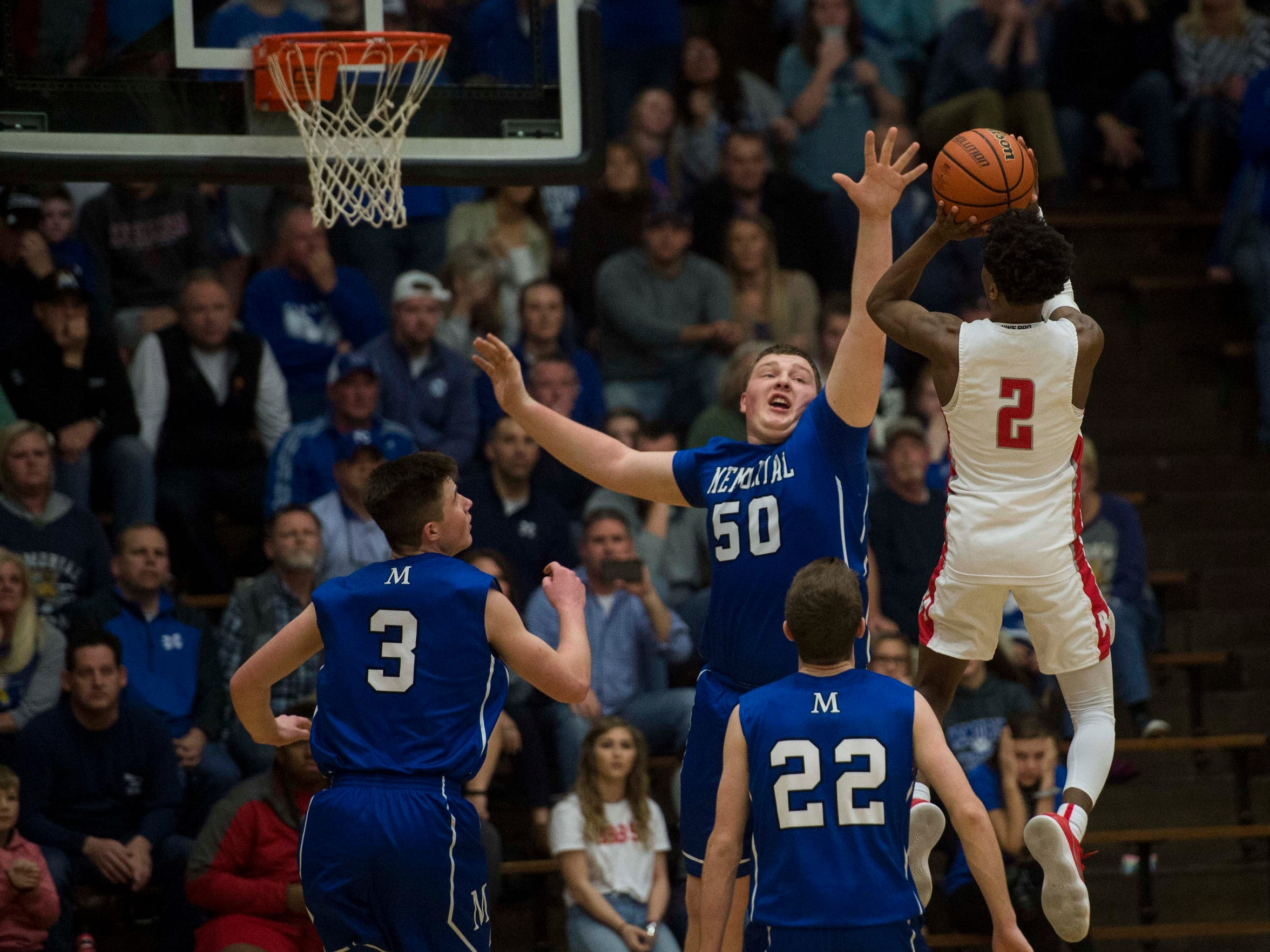 Bosse's Mekhi Lairy (2) takes a jump shot over Memorial's