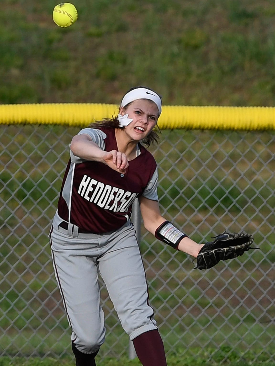 Henderson County outfielder Kaytlan Kemp throws to the infield as Henderson County plays Webster County in Dixon Thursday, April 13, 2017.