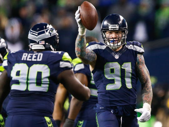 The Seattle Seahawks traded Cassius Marsh (91) to New