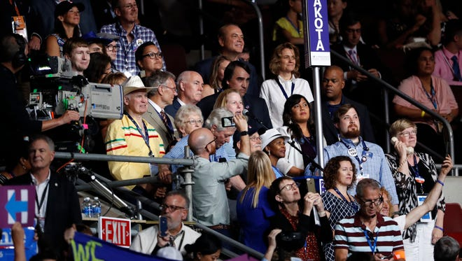 The South Dakota delegation votes during the second day of the Democratic National Convention in Philadelphia , Tuesday, July 26, 2016.