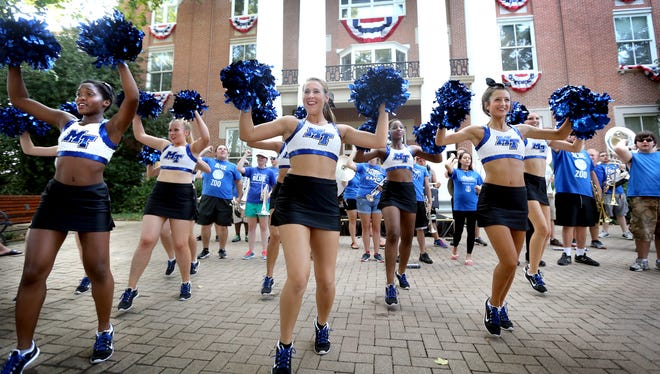 MTSU dance team members Paige Allen, left, Brooke Woodson, center, and Talia Ross, right dance with other members of the dance team to the MTSU fight song at the MTSU Pep Rally on the square in downtown Murfreesboro, Thursday, Aug. 20, 2015.