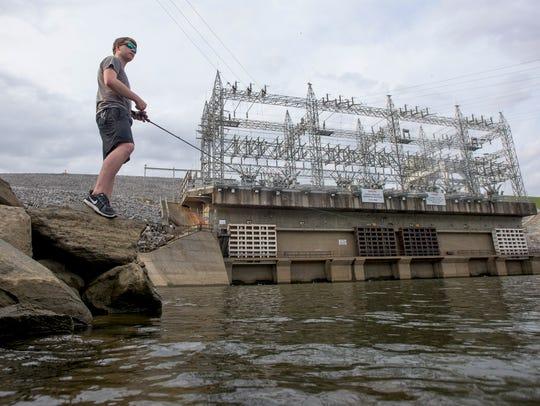 Drew Kelley, of Millbrook, Ala. fishes below Walter