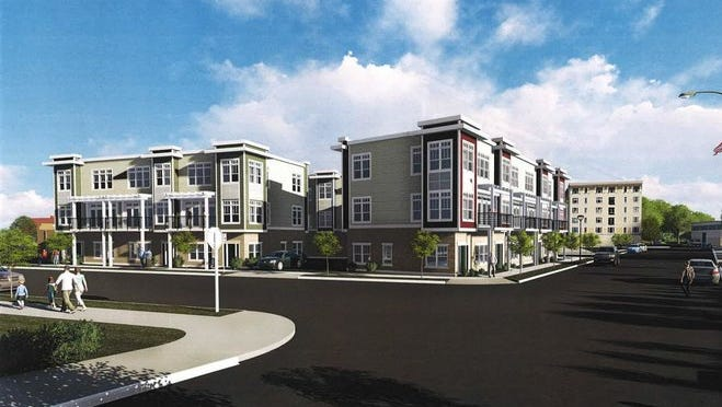 Developer Stephen Perry Smith is seeking a $365,000 loan from the downtown TIF district to finish construction on a three-story, 11-unit townhome project at 351 E. Pier St. in Port Washington.