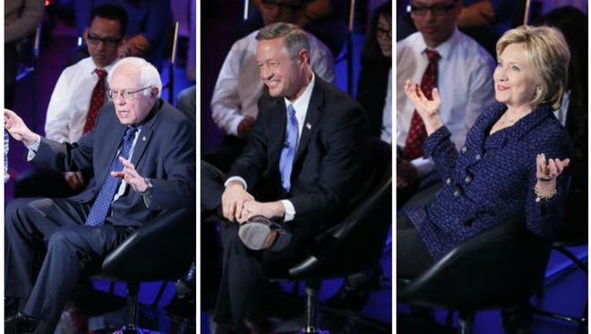 Democratic presidential candidates Bernie Sanders, Martin O'Malley and Hillary Clinton take questions during the Brown & Black Democratic Forum at Drake University Monday, Jan. 11, 2016.