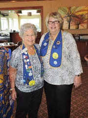 Evelyn Deggeller, left, accepts a 40-year Membership Award from outgoing President Suzy Hutcheson at the Soroptimist International of Stuart Installation of Officers/Annual Retreat.