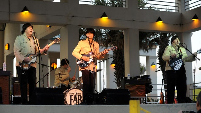 """Beatles tribute band Not Quite Fab performs  during Bands on the Beach at the Gulfside Pavilion on Pensacola Beach. From left are Dickie Williams as Paul McCartney, Jeff Fitzpatrick as Ringo Starr, Jim DeStafney as George Harrison and Glenn Vignolo as John Lennon. Beatles tribute band """"Not Quite Fab"""" perform for a large crowd Tuesday evening during Bands on the Beach at the Gulfside Pavilion on Pensacola Beach. Band members are, from left, Dickie Williams as Paul McCartney, Jeff Fitzpatrick as Ringo Starr, Jim DeStafney as George Harrison and Glenn Vignolo as John Lennon"""