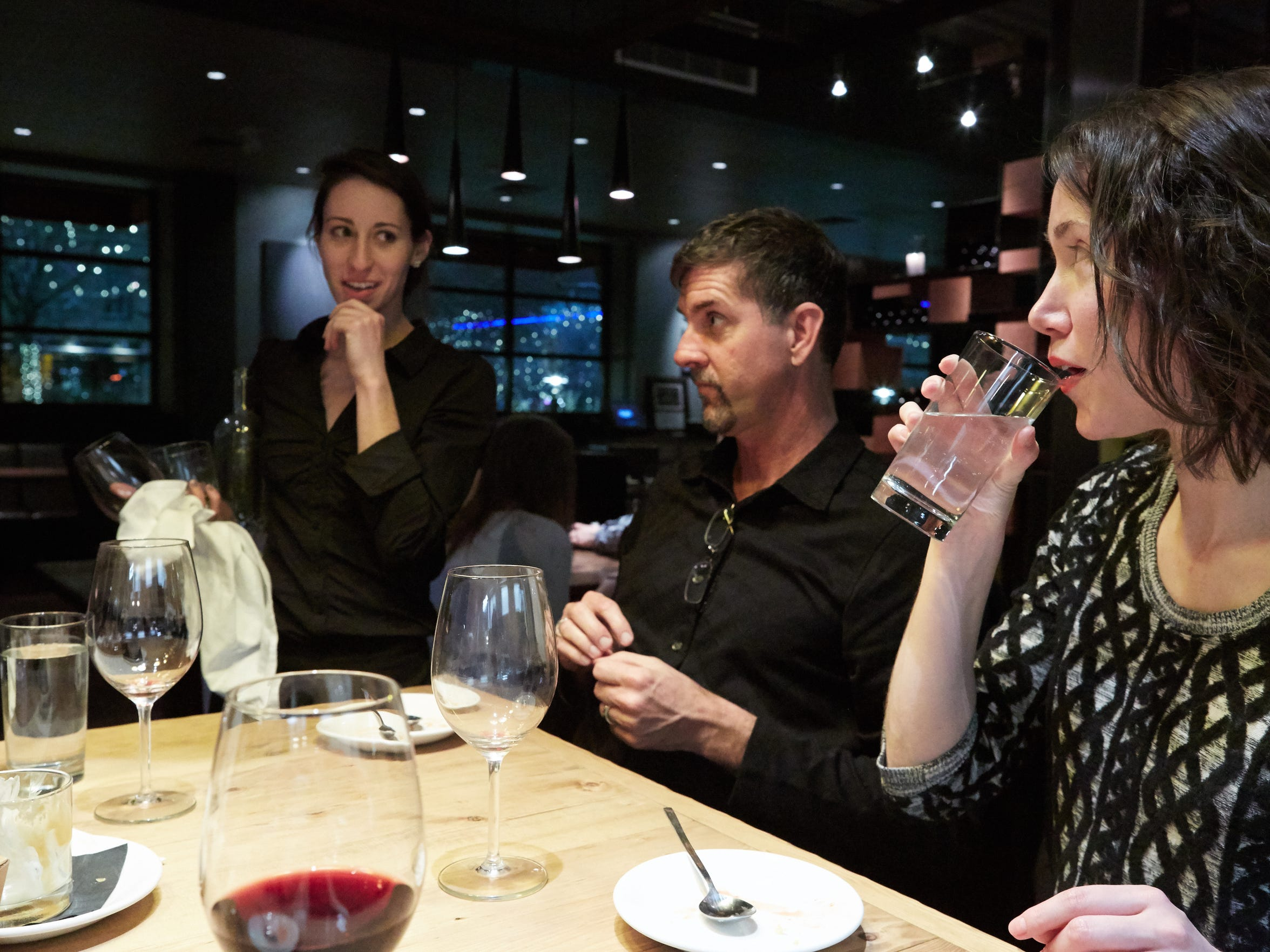 Michael Baietti and Josie Sexton discuss their dining experience with server Sarah during dessert at RARE Italian Sunday, January 11, 2015.