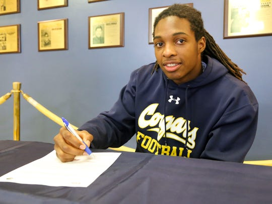 Tim White signs his National Letter of Intent on Wednesday at College of the Canyons.