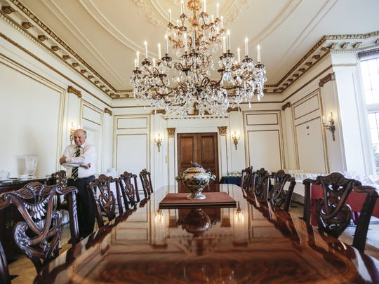 The dining room boasts intricate details from the ceilings to the marble floors seen here.