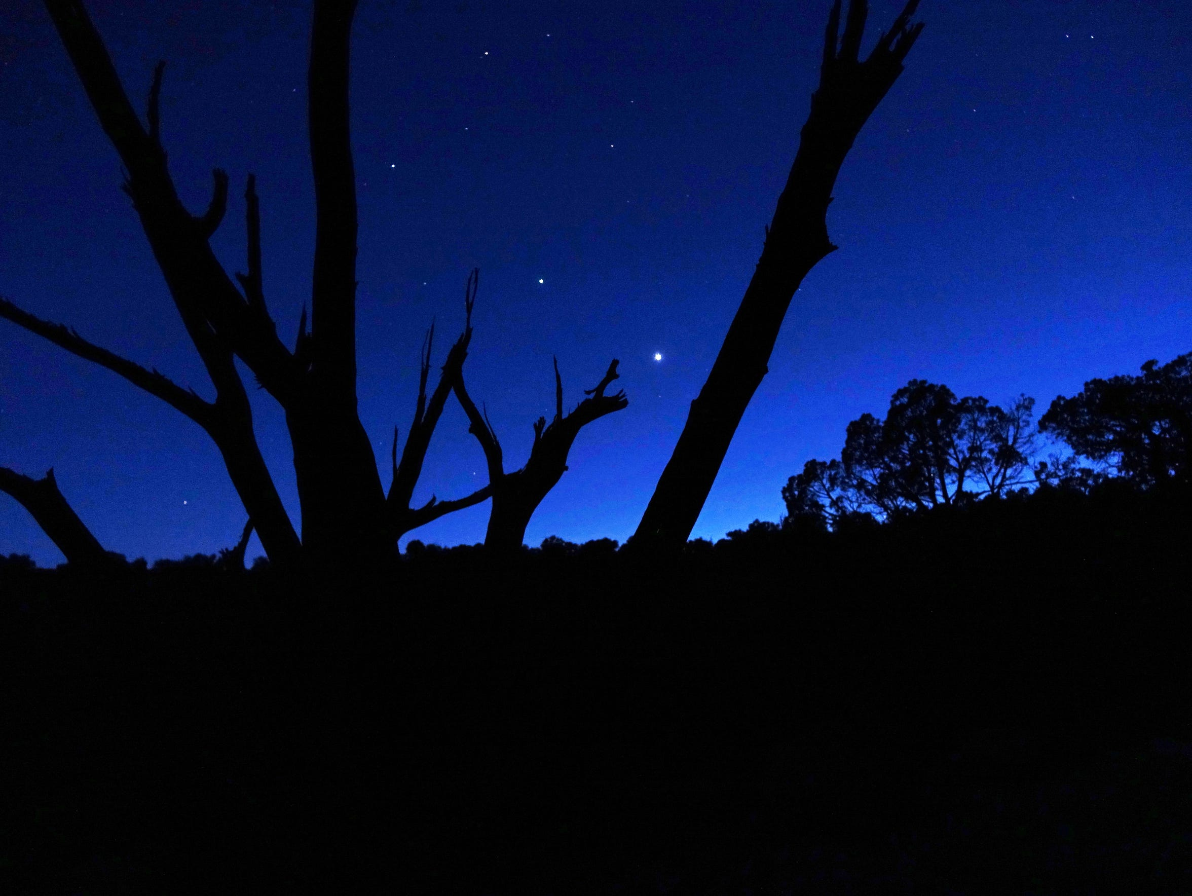 The western sky fading into darkness silhouettes a