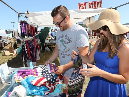 Frank and Carolyn Ruta of Harriman search for a sweater for their dog at the Stormville Airport Antique Show and Flea Market in Stormville on Saturday. The Stormville market has antique vendors as well as those who offer discounted items for your home or your pets.
