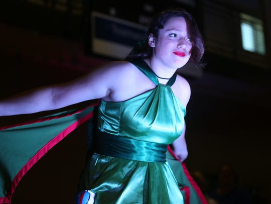 In this file photo, Emiliy Niederbremer, dressed as the Pokemon character Flygon, poses during the costume contest at the Fort Collins Comic Con on Sept. 12, 2015.