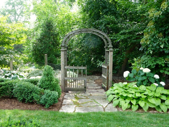 A garden gate marks the transition into the newest
