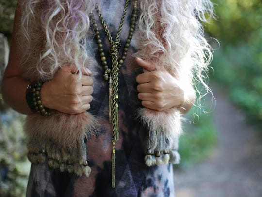 Layer long necklaces for a statement look.