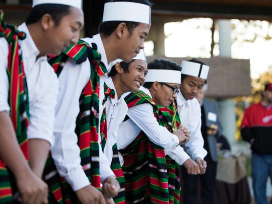 Members from the Burmese Catholic Association youth group perform a dance during BC Vision's 100-day celebration at Festival Market Square on Wednesday evening.