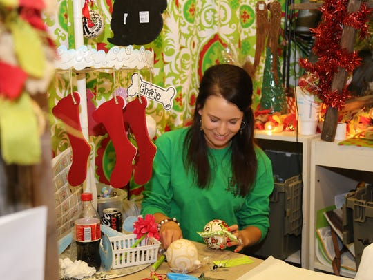 Allie Permenter decorates Christmas ornaments Saturday