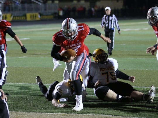 Fredericktown quarterback Dillon Smith rallied the Freddies with his legs in Saturday's 29-28 Division VI regional semifinal victory over Paint Valley.
