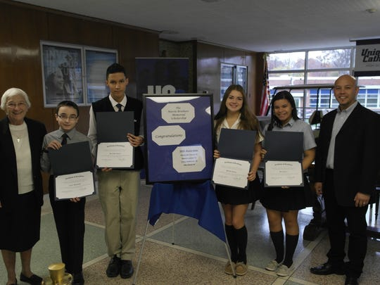 Left to right are Sister Percylee Hart, RSM, Principal of Union Catholic; Corey Makowski  of Winfield Park; Alexander Garcia  of Linden; Melissa Lettieri  of Clark; and Mia Oliveri  of Elizabeth; and Ron Kirtland, district supervisor for Navin Bros., Inc. All students class of 2019.
