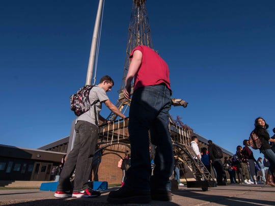 Delcastle sheet metal students Devon Hotchkiss (16), RIGHT, and John Foote (17) examines a scale version of the Eiffel Tower made of sheet metal created by students at Delcastle Friday, Nov. 20, 2015 at Delcastle in Wilmington.
