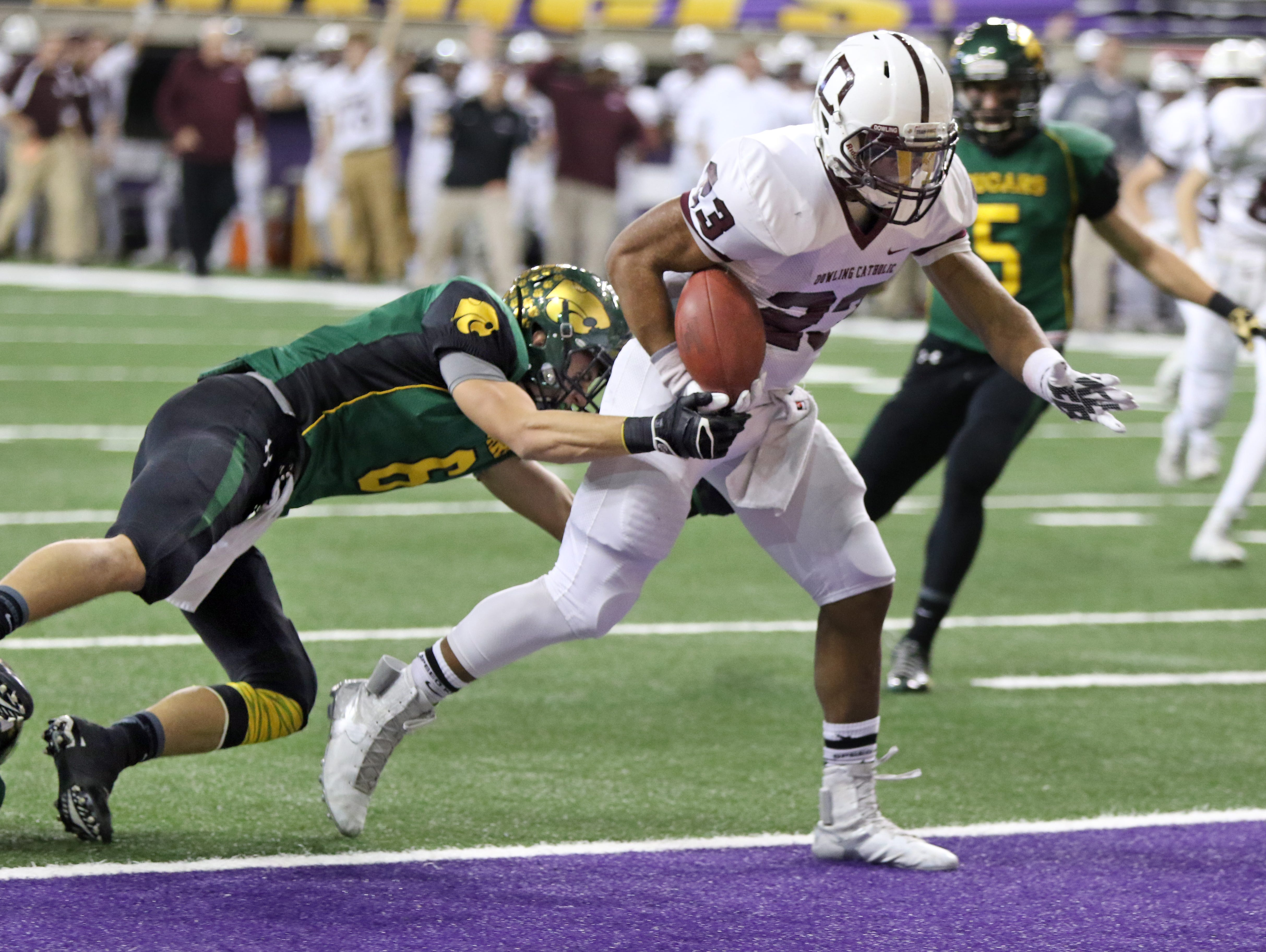 Jacob Zachary of Dowling Catholic runs for a touchdown against Cedar Rapids Kennedy in the Class 4A Championship game Monday, Nov. 23, 2015.