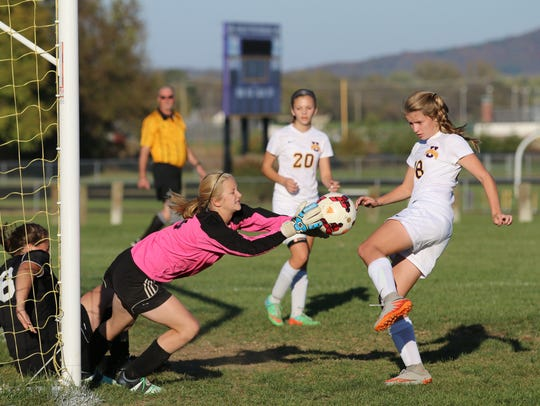 Unioto's Jayla Campbell scores a goal against Miami