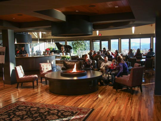 Visitors enjoy wine in the tasting room at Willamette
