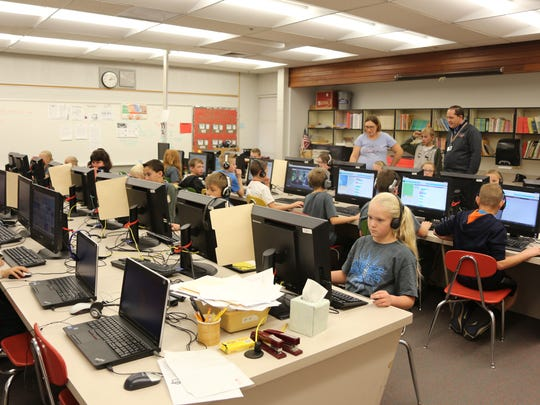 Students at Sunset Elementary learn computer programming during the week-long Hour of Code.