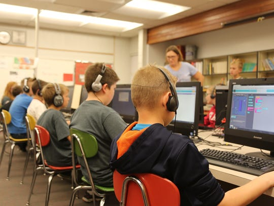 Students at Sunset Elementary learn computer programming