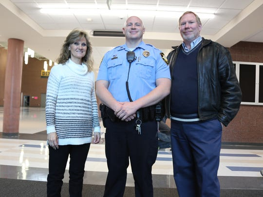 Dixie Middle School Assistant Principal Sheri Fisher, SRO Matt Schuman and Principal Tim Lowe.