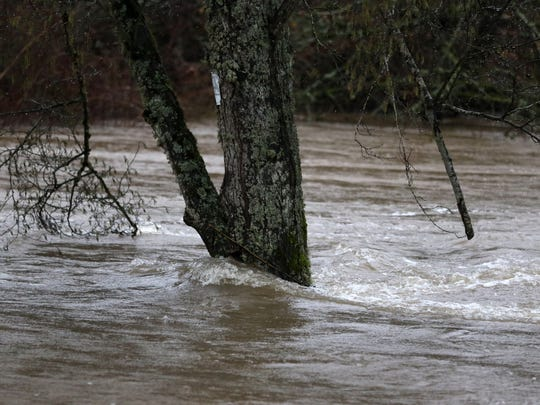 High water from Mill Creek along Delaney Road SE on Friday, Dec. 18, 2015, in Turner, Ore.