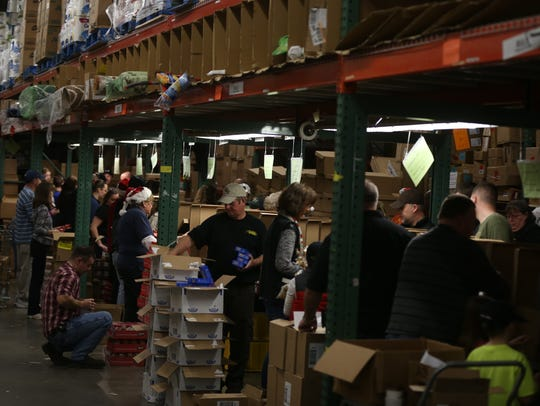 Dozens of volunteers packed boxes of food for Smyrna