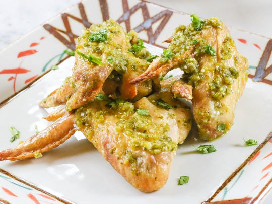 Chicken wings with Garlic Pepper Tomatillo Sauce.
