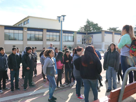 A CSUMB student speaks with visiting middle school students Wednesday on campus.
