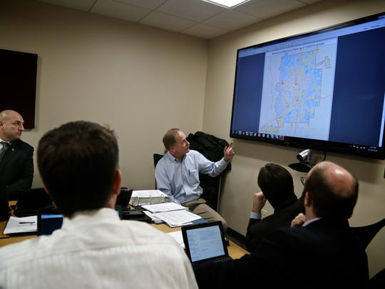 Keith Creagh, center, Director of the Michigan Department of Environmental Quality, during Mission Flint group meeting on Friday, January 29, 2016, at Michigan State Office building in Flint, MI. The group is an assembly of top state officials charged with helping fix the city's tainted water system and look ahead to broader solutions for a city that has long endured hard times ranging from disagreeing jobs to high crime.
