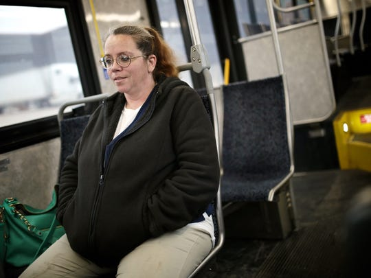 Kerrie Moore, 47, of Flint, MI, takes the the new Ride to Groceries bus to shop at Walmart on Tuesday, February 2, 2016, in Flint, MI. Moore is also an employee at Walmart. The bus service takes residents to three grocery stores on the outskirts of city of Flint.